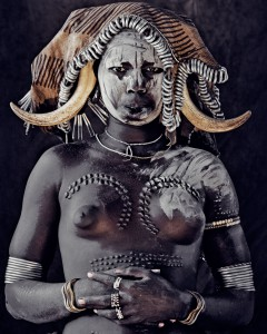 Woman of the Ethiopian Mursi clan. Image by J Nelson, from beforethey.com